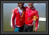 Image of Ryan and Hugues Showing Their Gold Medals