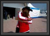 Image of Christine Bain Giving Ryan a Big Hug For His Mother