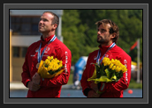 Image of Ryan and Hugues on Podium Looking at Canadian Flag With Bronze Medals After K2 200m Final at World Cup 1 in Poznan, Poland