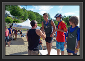 Image of Ryan presents medals at Lac-Beauport to winners of Régate régionale du Lac Beauport. Photo: Stéphane Messier