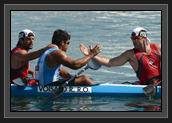 Image of Argentina's Ruben Oscar Voisard Rezola is greeted by Canada's Ryan Cochrane (R) and Hugues Fournel at the end of their kayak double (K2) 200m men's semifinal during the London 2012 Olympic Games, at Eton Dorney Rowing Centre in Eton, west of London, on August 10, 2012. (Photo: FRANCISCO LEONG/AFP/GettyImages)