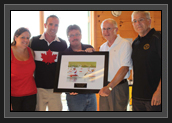 Image of Ryan receiving his signed photo/plague that will stay on the wall at the Pisiquid Canoe Club in Windsor