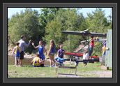 Image of Ryan giving some high fives to the Pisiquid Canoe Club athletes