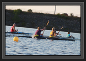 Image of Ryan paddling with athletes of the Pisiquid Canoe Club