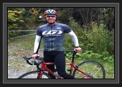 Image of Ryan biking with club teammate Pierre Luc Poulin