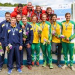Ryan, Mark, Hugues and Etienne with medals in front of podium for the K4 200m win (Photo: Balint Vekassy)