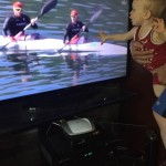 Son Logan touching tv as he watches his father Ryan in K2 200m at the Olympics